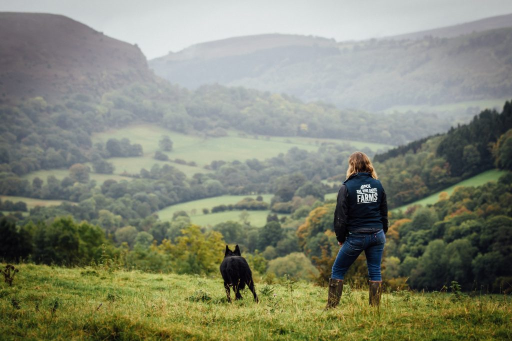 She who dares farms. Shepherdess looking over her farm.
